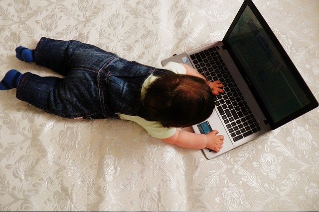 Baby Working from Home on Laptop